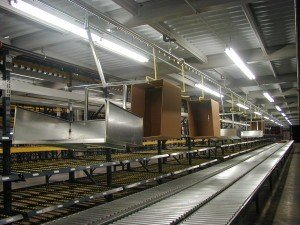 empty carton delivery and corrugated trash removal conveyor system