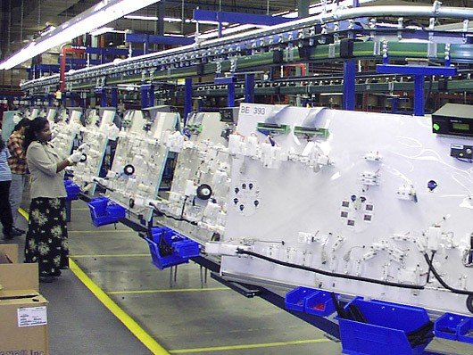 Overhead conveyors for automotive assembly lines and other manufacturing assembly lines.