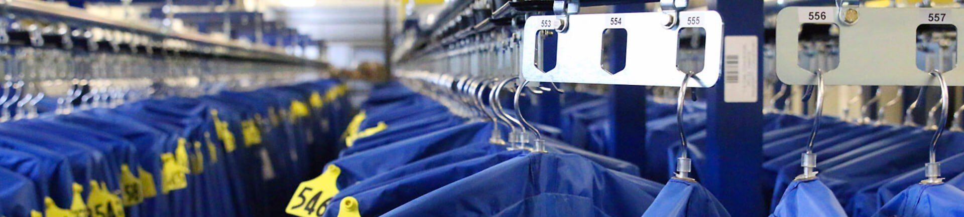 Garment handling conveyor systems for uniforms, inmate property and coat checks
