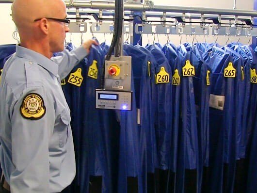 Conveyors for inmate property storage in correctional centers