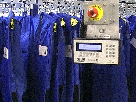 Control system to locate and retrieve items on an ASRS overhead conveyor.