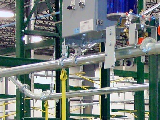 Close up photo of overhead enclosed tube conveyor track.