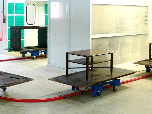 Photos of recently installed floor mounted towline conveyors.
