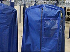 Bags for garment storage on a conveyor system.