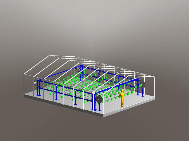 Overhead conveyor automates the movement of plants from the load area in a greenhouse.
