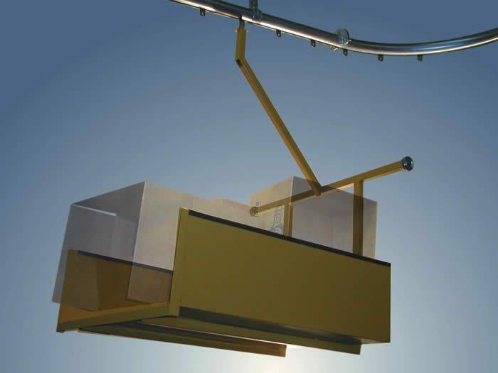 Trash Handling carrier for overhead conveyor.