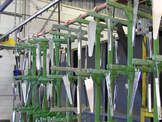 Overhead conveyors for metal finishing processes including electrocoating and electroplating.