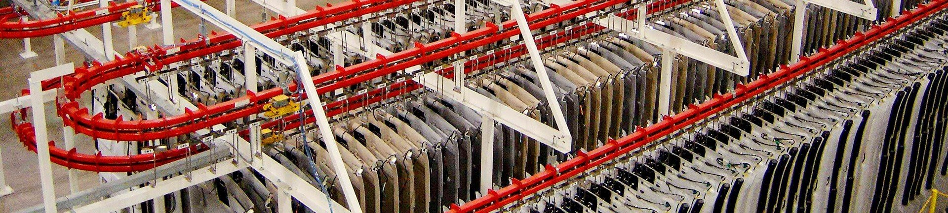 Conveyors for work in progress such as close pack accumulation of product during manufacturing.