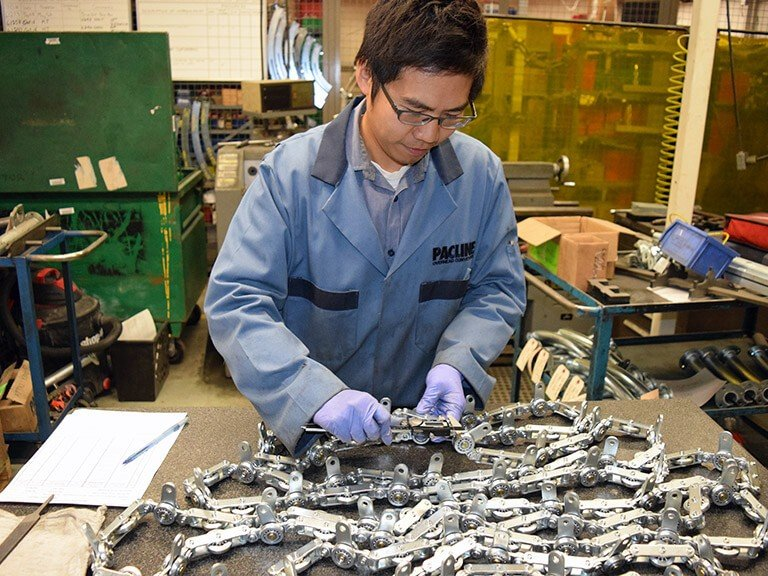 PACLINE always testing overhead conveyor chains for quality