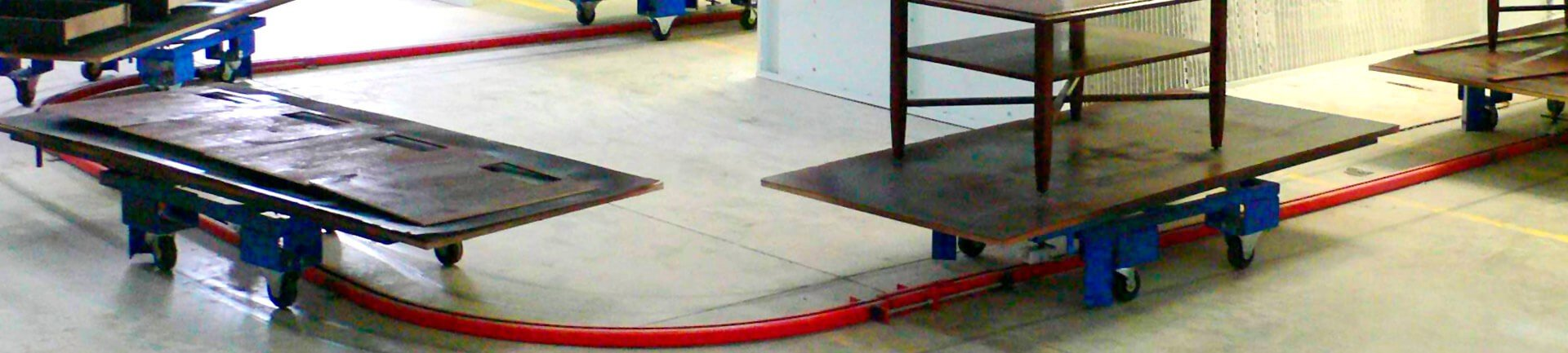 On floor or in floor towline conveyor system carts have rotating top platens