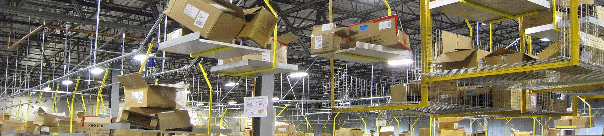 Conveyor removes corrugated carton trash in warehouses and distribution centers.
