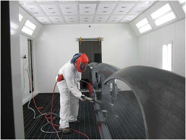 Heavy duty inverted conveyor for wet spray paint line.