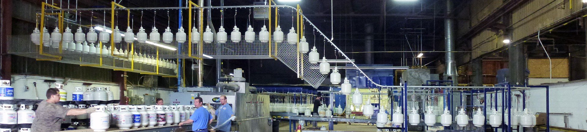 Enclosed track conveyor for wet spray paint line