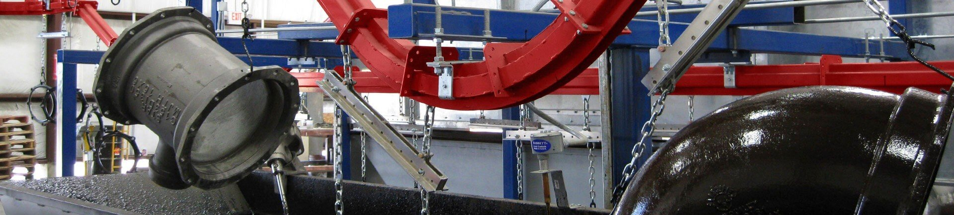 Overhead conveyors are a great option for handling products through an automated finishing system involving dip tanks.