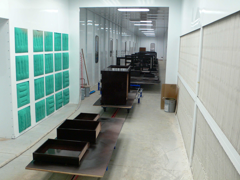Towline floor conveyor for wet spray finishing application.
