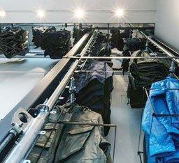 Over/under conveyor for garment storage