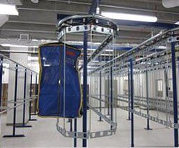 Two tier conveyor system for inmate property storage allows double the capacity in the same space.