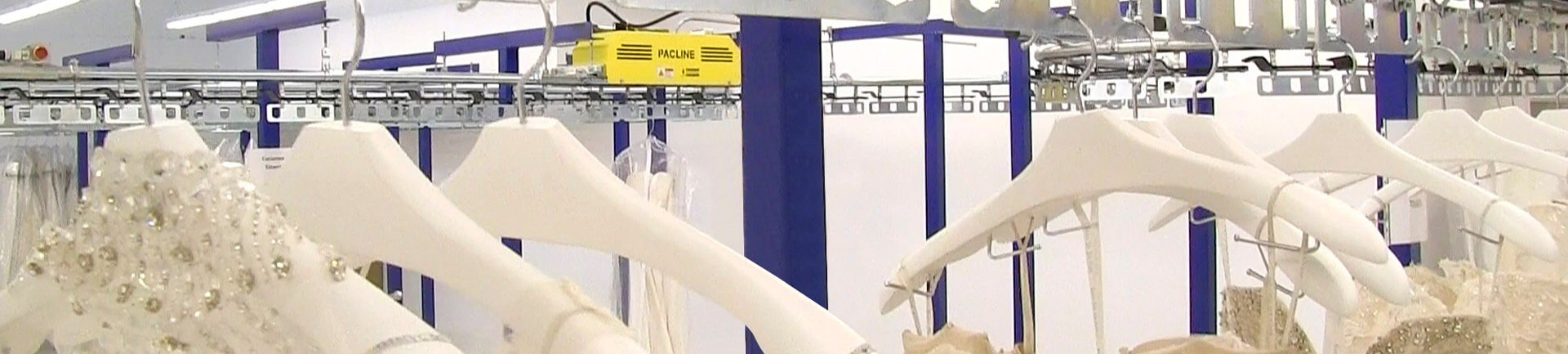 Garment handling conveyor for storage and retrieval of costumes, bridal gowns and other hanging garments.