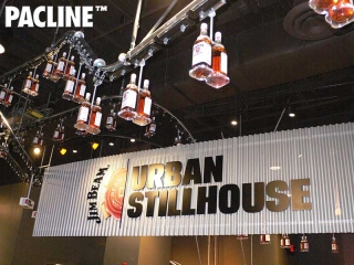Jim Beam uses a Pacline creative retail conveyor to produce a unique bottling display.
