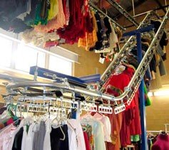 Garment handling conveyor that runs from the floor to the ceiling.