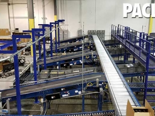 Enclosed Track overhead conveyor carrying empty boxes for an empty distribution warehouse.