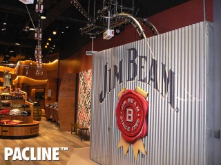 Jim Beam Stillhouse uses a creative retail conveyor to produce a unique bottling display.