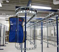 Single track, two tier garment conveyor system.