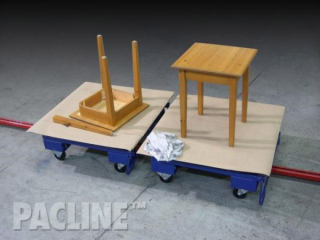 Towline conveyor with rotating top that allows access to all sides of furniture piece through assembly process.
