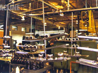 Overhead conveyor with double decker carriers for assembly of appliance motors.