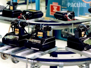 Assembly line use of The PAC-LINE™ floor mounted conveyor system.
