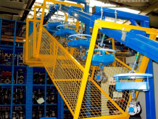 PAC-MAX Heavy Duty enclosed track conveyor used for auto part assembly line.