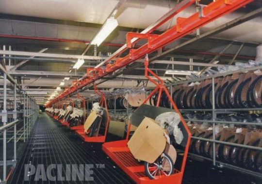 Custom carries built to move bicycles through assembly on PAC-MAX overhead conveyor system.