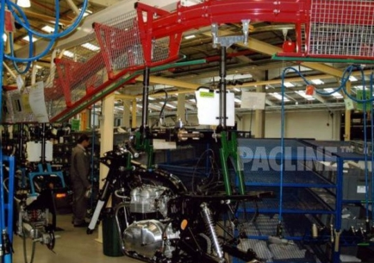 Heavy duty PAC-MAX overhead conveyor used to move motorcycles through assembly process.