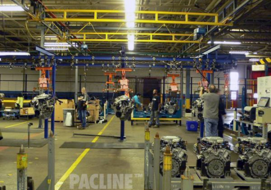 The PAC-BEAM I beam conveyor is used to transport heavy automotive engines through the assembly process.