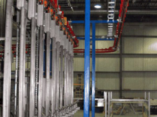 Automotive parts are transferred between assembly operations using the PACLINE's power and free conveyor.