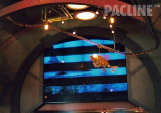 A closer look at the PAC-LINE creative display conveyor system installed in Steven Spielberg's restaurant to carry miniature ships.