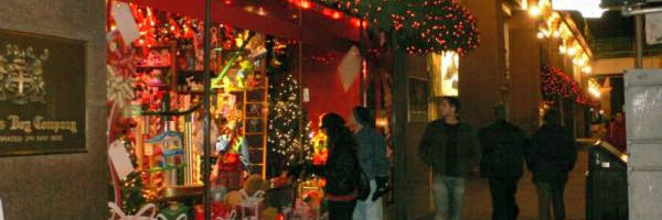 Hudson Bay store window attracts customers with a display animated by a conveyor moving gifts in Santa's workshop.