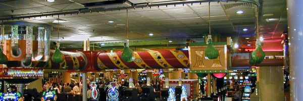 PAC-LINE conveyor in casino used to display and circulate plastic money bags overhead casino goes.
