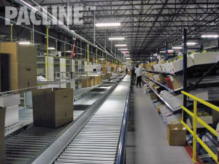 Empty carton delivery to three level picking module in distribution warehouse. Same system used to remove trash.