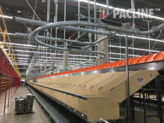 Empty tote conveyor project in a retail Distribution Center.  Approximately 1300 feet long, delivering totes to operators.