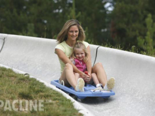 Family enjoys alpine sleds at Winter Park Colorado. Our conveyor is used to accumulate and deliver sleds to patrons.