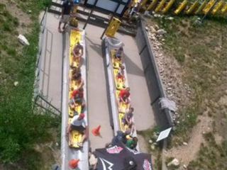 Pacline's enclosed track overhead conveyor is used to accumulate and carry alpine sleds to riders.