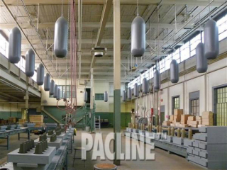 Munitions being conveyed by The PAC-LINE enclosed track overhead conveyor on the Bomb Girls assembly line movie set.