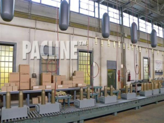 The PAC-LINE enclosed track overhead conveyor carries munitions on an assembly line in this Bomb Girls movie set.