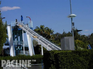 Water park sleds are transported by the PAC-LINE™ enclosed track conveyor to return them to the top of slide.