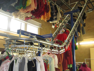Hundreds of clothing items are cataloged and organized for easy, quick retrieval with PACLINE's automatic storage and retrieval conveyor.