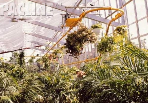 Enclosed track monorail conveyor in nursery and greenhouses for plant display and automated watering systems.