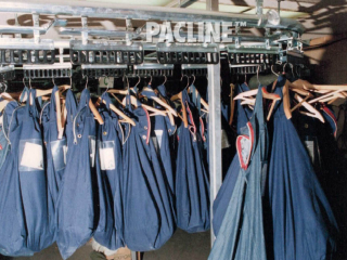 Automated garment retrieval system in detention centre handles inmate property storage bags of various weights and sizes.