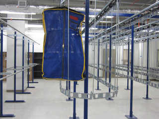 single track, PACLINE conveyor with carriers designed to double the capacity for storing full length garment bags.