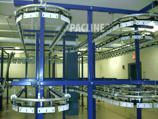 High density garment storage and retrieval conveyor can handle up to 100 lbs. per two-pendant rack.
